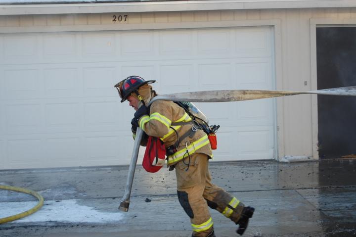Captain pulling hose
