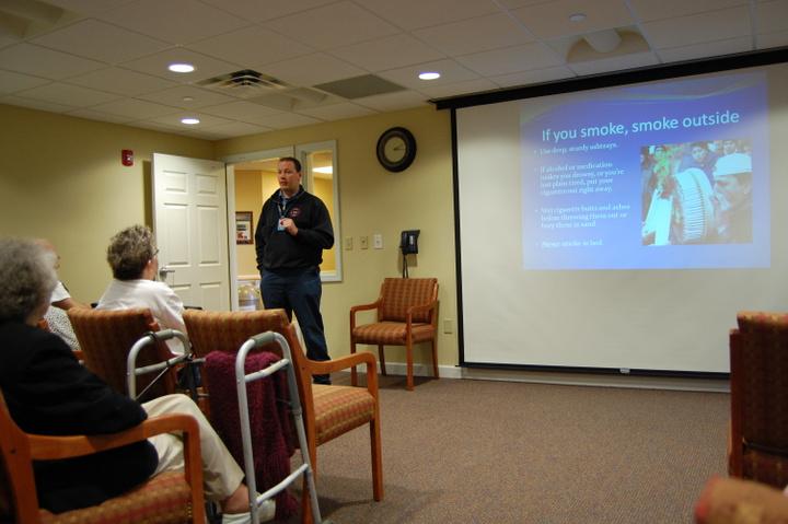 Captain Jesse Schmidt speaking at a retirement community